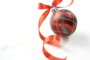 Christmas ball with red bow on white