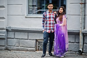 Stylish indian hindu couple posed on