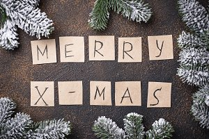 Festive background with text Merry X