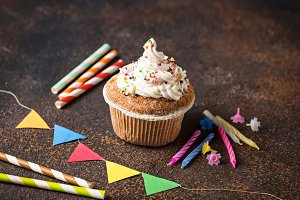 Birthday cupcake with cream and