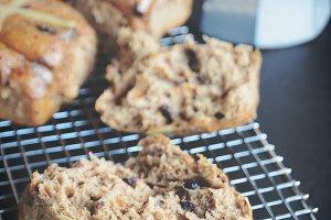Warm hot cross buns with coffee