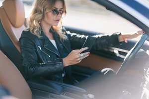 Photo of driver girl with phone in