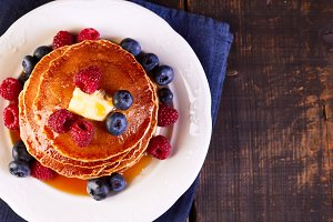 Pancakes with fresh berries maple