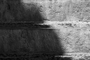 Black and white old stone stairs wit