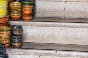 Pile of ceramic bowls of various siz