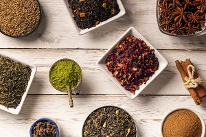 Different spices on wooden table