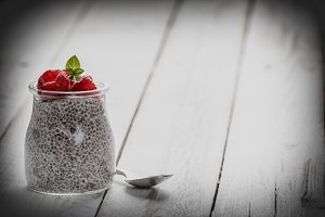 Glass jar of chia pudding with raspb