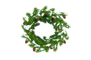 Christmas wreath in snow, pinecones