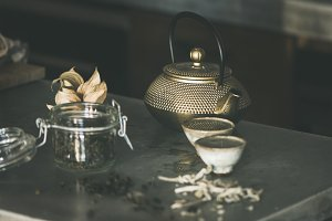Golden iron teapot and japanese cups