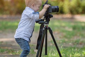 A two years old boy is photographer