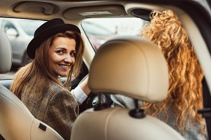 portrait of smiling woman driving ca