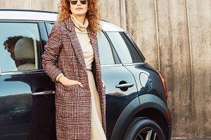 adult female model in coat and sungl