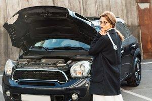 female woman in coat and eyeglasses