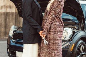 two stylish female models in coats h