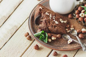Piece of chocolate cake, mint leaves