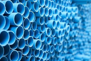 Blue PVC pipes stacked