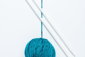top view of blue yarn ball  and knit