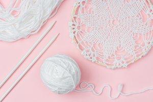 flat lay with white yarn and knittin