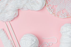 top view of white yarn and knitting