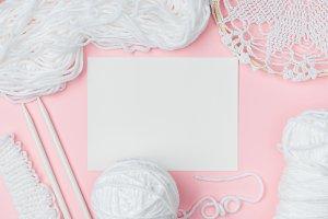 flat lay with white yarn, knitting n
