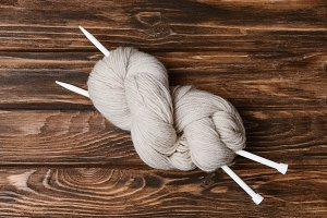 top view of white yarn clew with kni