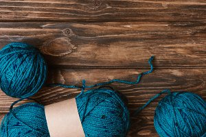 flat lay with blue yarn clews on woo