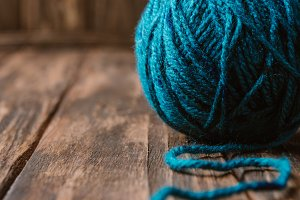 close up view of blue yarn clew on w