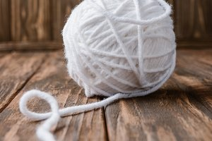 close up view of white yarn clew on