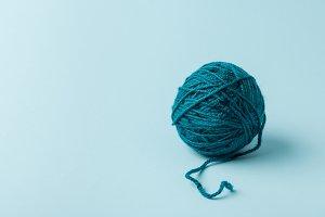 close up view of blue yarn ball on b