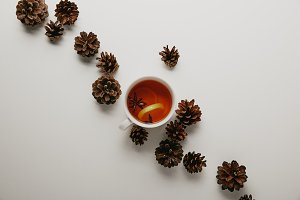 flat lay with pine cones and cup of