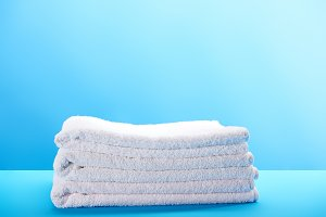 pile of clean soft white towels on b