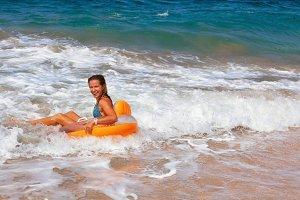 Happy girl have fun in sea surf