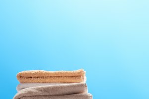 stack of clean fresh towels on white