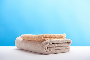 stacked clean towels on white table