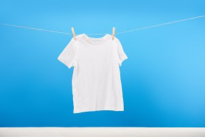 clean white t-shirt hanging on cloth