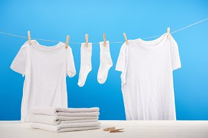 pile on clean towels, clothespins an