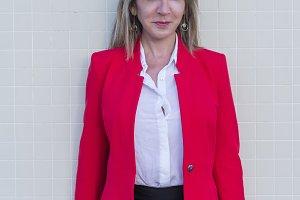 Portrait of a blonde woman wearing r