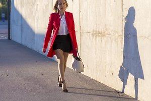 Blonde woman wearing red jacket walk