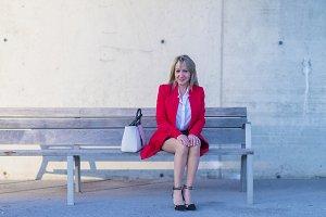 Portrait of a blonde woman sitting o