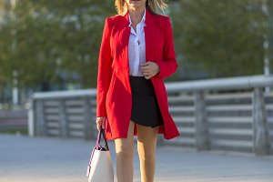 Blonde woman wearing red jacket and