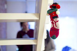 Red Christmas sock on wooden stairs