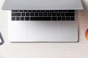 top view of laptop, apple, vegetable