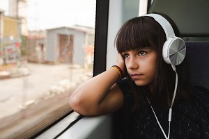 Little girl listening to music while