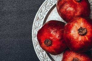 flat lay with fresh pomegranates on