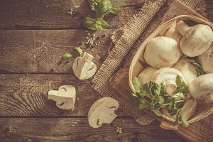 Mushrooms on rustic wood background