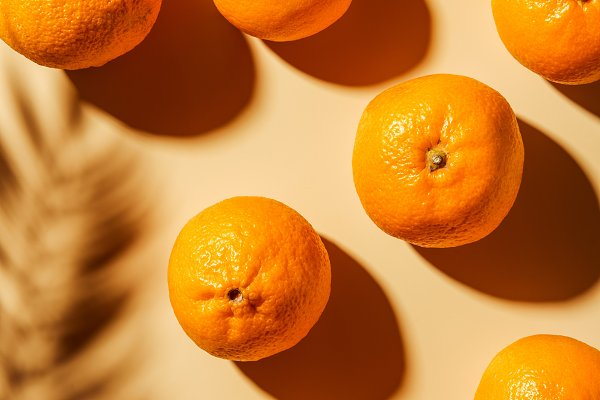 Food Stock Photos: LightField Studios - Top view of tangerines and twig shad