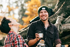 adult couple laughing and having tea