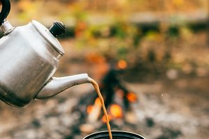 coffee pouring out of metallic kettl