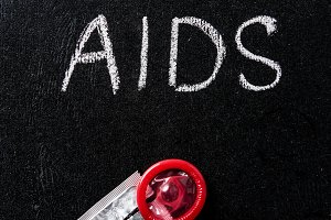 top view of aids sign and red condom