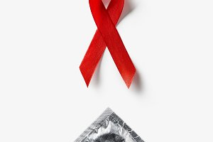 top view of aids awareness red ribbo